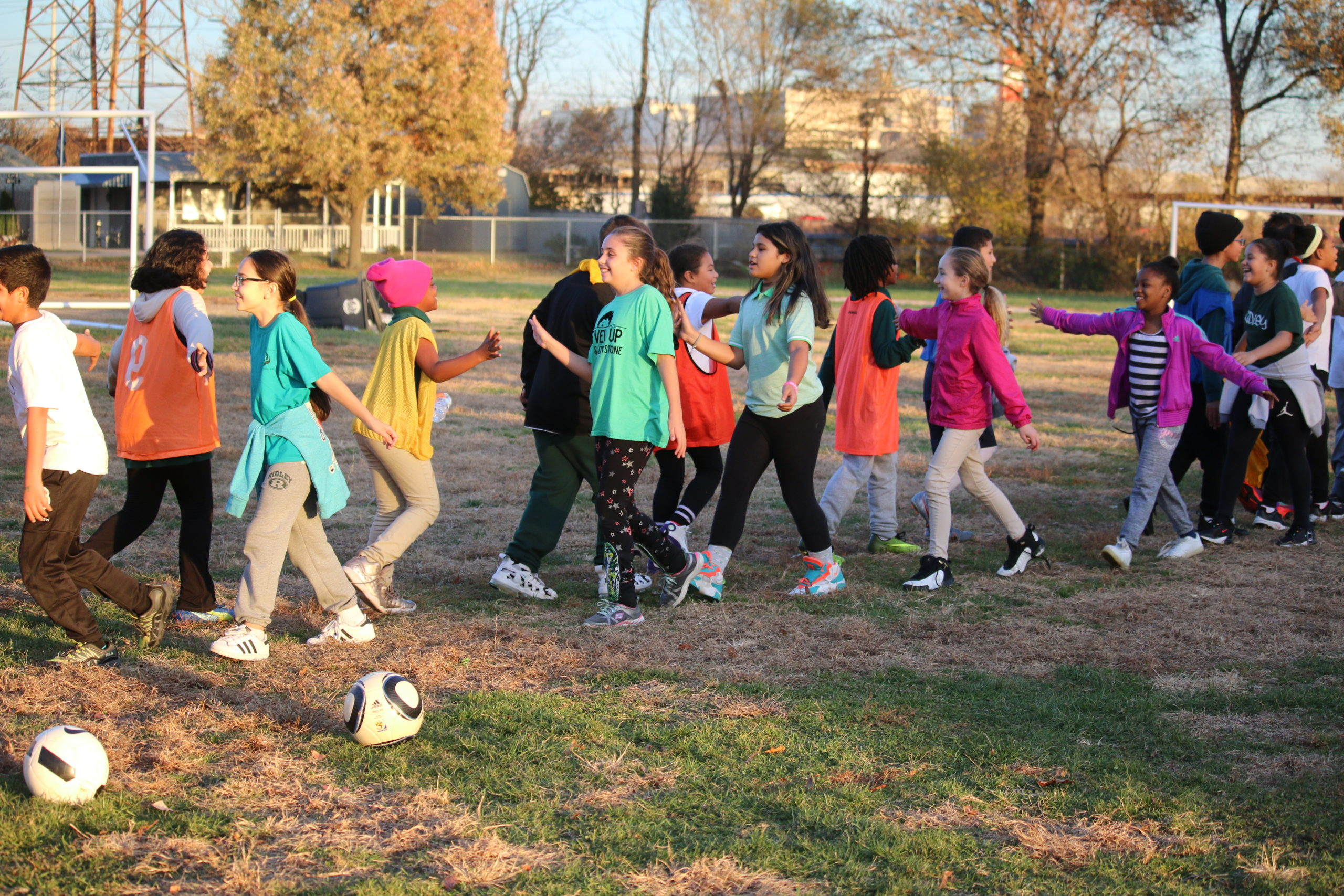 Soccer for Success Players Shaking Hands